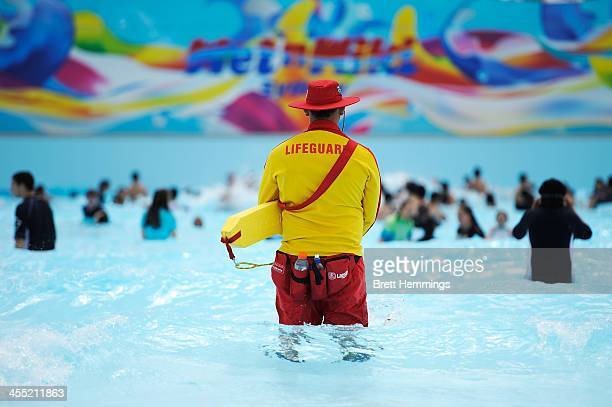 Lifeguard watches over the wave pool at the opening of Sydney theme park Wet'n'Wild on December 12 2013 in Sydney Australia The new water park...