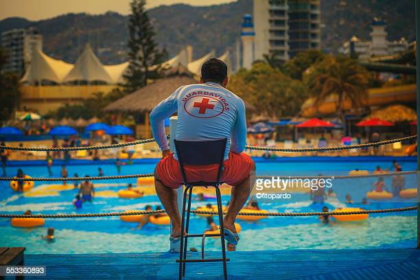 Lifeguard watching swimmers in a water park