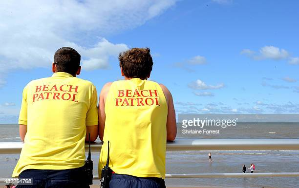 Lifeguards Mike Ashfield and Joe Matthews stand guard on beach patrol on July 29 2015 in Blackpool England