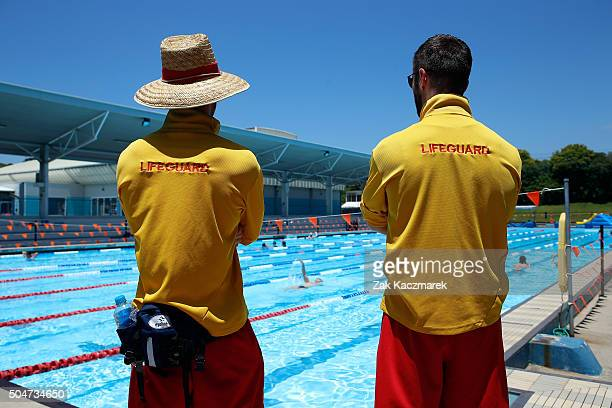 Lifeguards patrol the pool at Ashfield Aquatic Centre on January 13 2016 in Sydney Australia Temperatures are expected to rise above 40 degrees in...