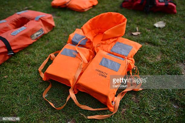 A lifejacket that has been used by a refugee to cross the sea to Europe is laid out in Parliament Square on September 19 2016 in London England 2500...
