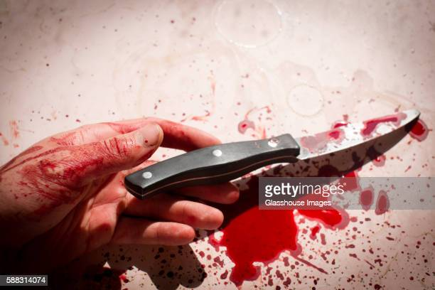 Lifeless Hand With Knife Covered in Blood