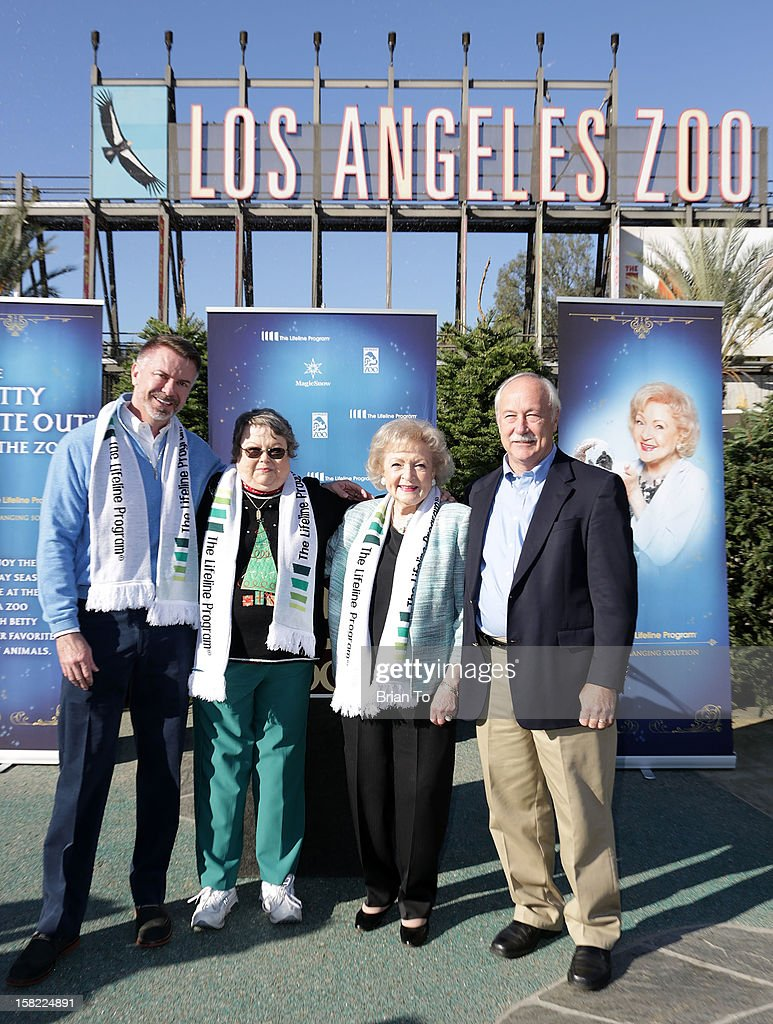 Lifeline Program Founder and CEO Wm. Scott Page, winner of The Lifeline Program's national 'Bucket List' Facebook contest Leslie Scott, actress Betty White, and Los Angeles Zoo Director John R. Lewis attend Betty 'White Out' Tour at The Los Angeles Zoo with The Lifeline Program at Los Angeles Zoo on December 11, 2012 in Los Angeles, California.