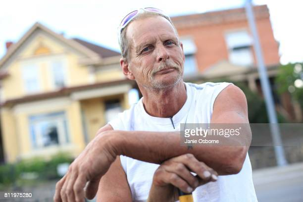 Lifelong Butte resident Randy Scott stands for a portrait near a residence on which he just completed roofing work in a neighborhood near downtown...