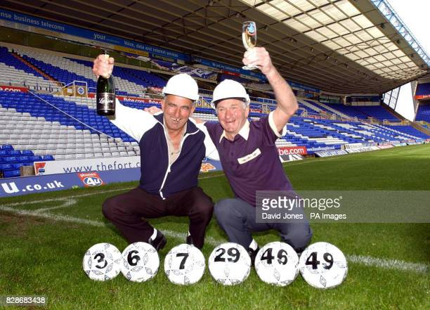 Lifelong friends and football rivals Alf Cole and John Radford from Stourbridge West Midlands celebrate after picking up a Lotto cheque for 5971 at...