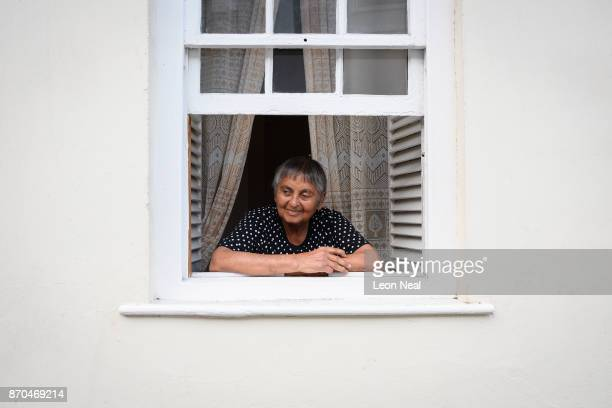 Lifelong resident Shirley George watches the comings and goings on the main street from her living room window on October 26 2017 in Jamestown Saint...