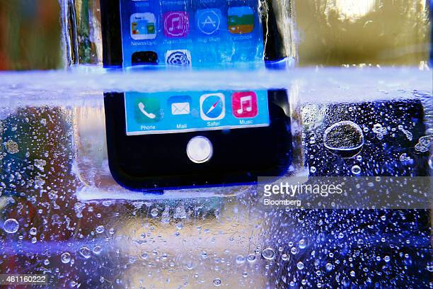 A LifeProof Fre waterproof case for the Apple Inc iPhone 6 case is submerged in water and ice during the 2015 Consumer Electronics Show in Las Vegas...