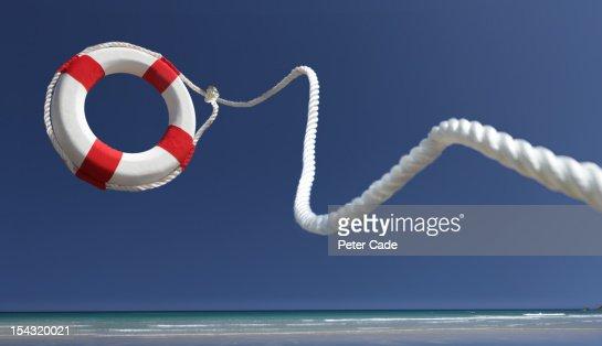 Lifering in air on beach