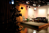 TV production studio with a stage being set up with props and proper lighting