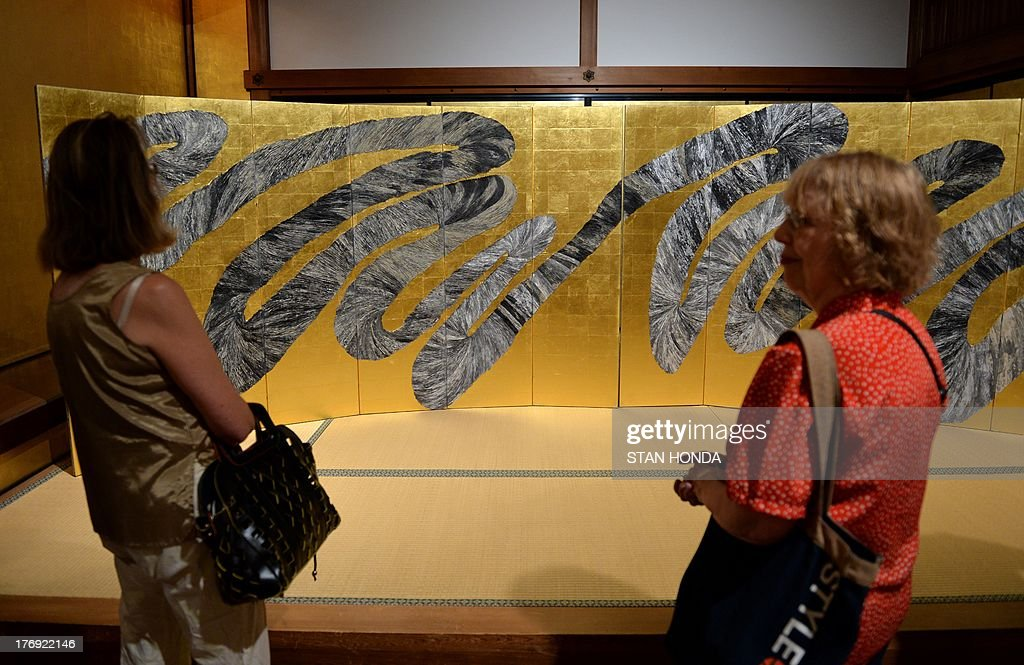 'Life's Symphony (Kyoku)', 2011, a pair of six-panel folding screens by contemporary Japanese artist Maio Motoko on display in the exhibition 'Brush Writing in the Arts of Japan' August 19, 2013 at The Metropolitan Museum of Art in New York. AFP PHOTO/Stan HONDA CAPTION