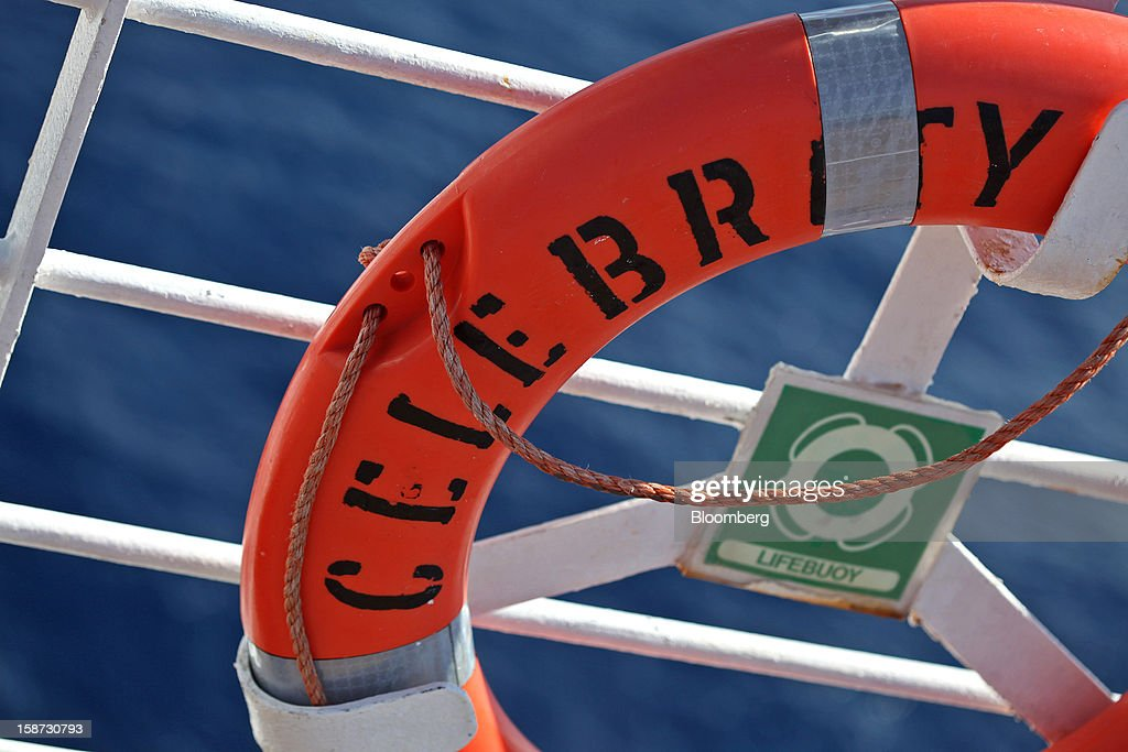 A lifesaver ring hangs from a railing aboard Celebrity Cruises Inc.'s Constellation cruise ship in the Caribbean Sea near the coast of Cuba on Wednesday, Dec. 19, 2012. Royal Caribbean Cruises Ltd. operates Azamara Club Cruises, Celebrity Cruises, CDF Croisieres de France, Pullmantur Cruises and Royal Caribbean International. Photographer: Tim Boyle/Bloomberg via Getty Images