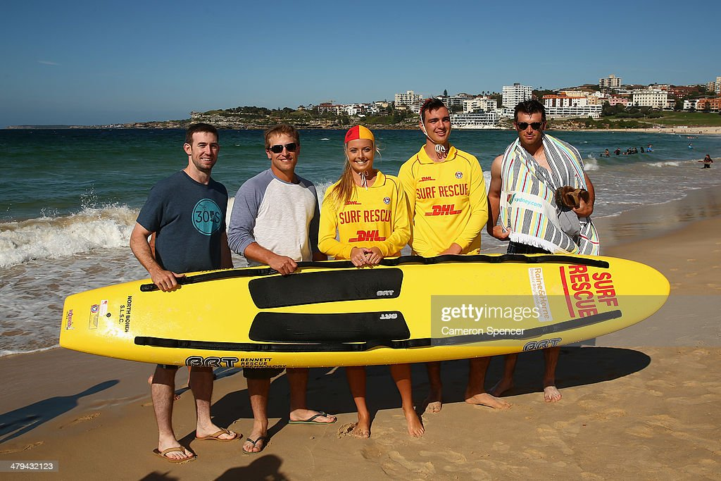 Lifesaver Sophie Thomson poses with (L-R) Mike Baxter, Tim Federowicz, Drew Butera and Chris Withrow of the Los Angeles Dodgers during a Los Angeles Dodgers players visit at Bondi Beach on March 19, 2014 in Sydney, Australia.