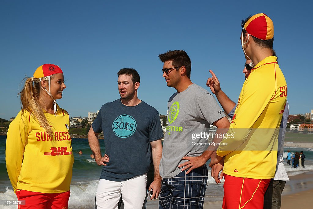 Lifesaver Sophie Thomson talks to Mike Baxter, Drew Butera and Tim Federowicz of the Los Angeles Dodgers during a Los Angeles Dodgers players visit at Bondi Beach on March 19, 2014 in Sydney, Australia.