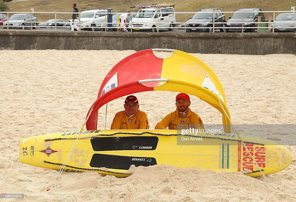 Lifesavers seek shelter from the wet and windy conditions at Bondi Beach on December 25, 2012 in Sydney, Australia. Traditionally beaches such as Bondi Beach are popular destinations for tourists and locals alike to celebrate Christmas Day.