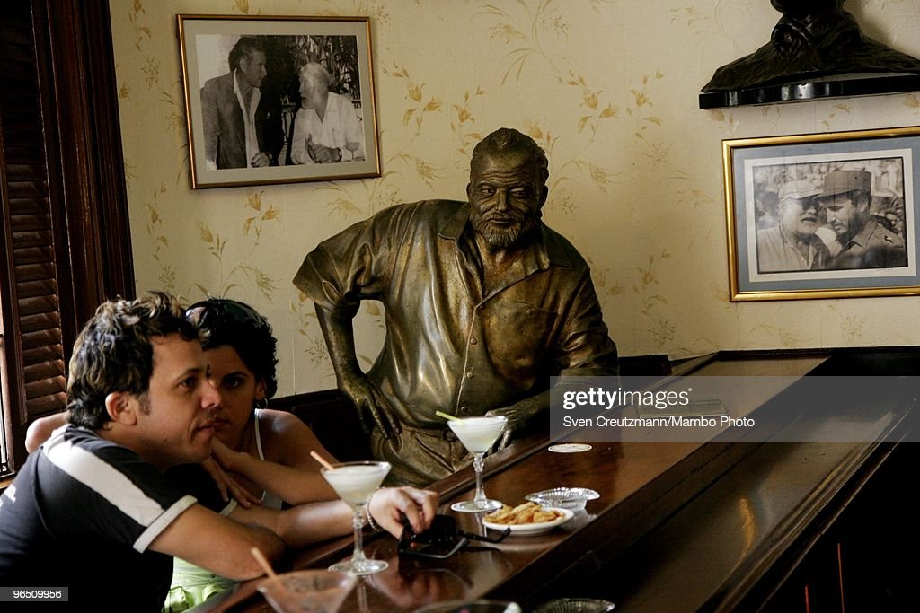 A life-size bronze statue of American writer Ernest 'Papa' Hemingway, Literature Nobel Prize winner, leans on the bar at his regular spot at the Bar, Restaurant El Floridita, on March 15, 2007, in Havana, Cuba. The American writer and journalist Hemingway used to drink his rum cocktail 'Papa Daiquiri' in the Floridita, when he lived in Cuba between 1939 and 1960. The waiters at the bar honour Hemingway by placing a Daiquiri cocktail every day before the statue, which was made by Cuban artist Jose Villa. It was in Cuba where Hemingway wrote his novel The Old Man and the Sea, which earned him both the Pulitzer Prize and the Nobel Prize in Literature.