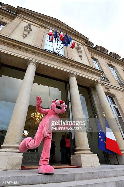 Lifesize cartoon character of the Pink Panther poses on the stairs of the Elysee presidential Palace in Paris at the end of the Christmas party on...