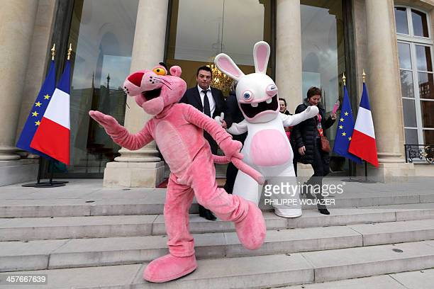 Lifesize cartoon characters of the Pink Panther and Raving Rabbit pose on the stairs of the Elysee presidential Palace at the end of the Christmas...
