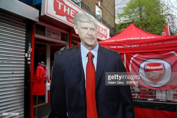 A lifesize cutout of Arsenal manager Arsene Wenger amongst merchandise stalls outside the ground seen before the game