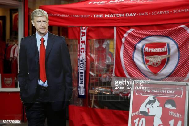 A lifesize cutout of Arsenal manager Arsene Wenger amongst merchandise stalls outside the Emirates