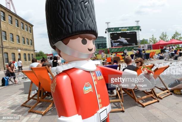 A lifesized Playmobil Royal Guard takes a break from his duties to enjoy the Wimbledon final in central London as part of the Playmobil 40th year...