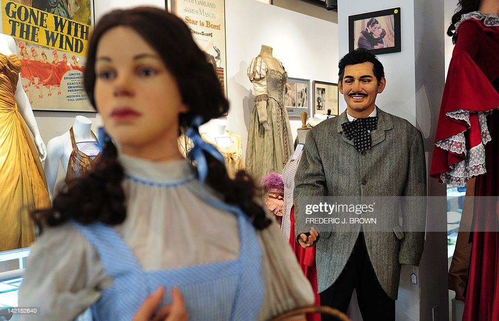 A life-sized wax figure of actor Clark Gable, dressed in the 'riding jacket' from the film 'Gone With the Wind' stands on display behind a figure of Judy Garland from the film 'The Wizard of Oz' ahead of an auction in Beverly Hills on March 30, 2012 California. A collection of Hollywood costumes, props, memorabilia and figures will be auctioned this weekend at Julien's Auction House, covering the Roaring Silent Film Period to Action Packed Super Heroes. The riding jacket worn by Gable in the film is estimated between $10,000 and 15,000.00. AFP PHOTO/Frederic J. BROWN AFP PHOTO/Frederic J. BROWN