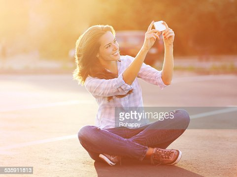 Lifestyle summer portrait happy pretty young woman doing a self- : Stock Photo