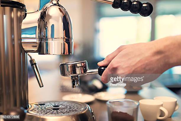 Lifestyle - Young man making espresso at home