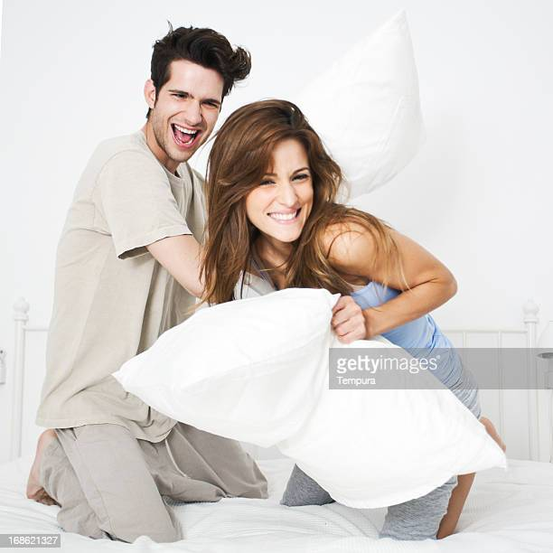 Lifestyle young playful couple relaxing on bed-room.
