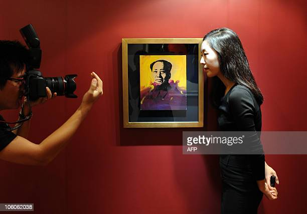 LifestyleartauctionChinaHongKong ADVANCER by Peter Brieger A photographer positions a public relations representative for a pose next to US artist...
