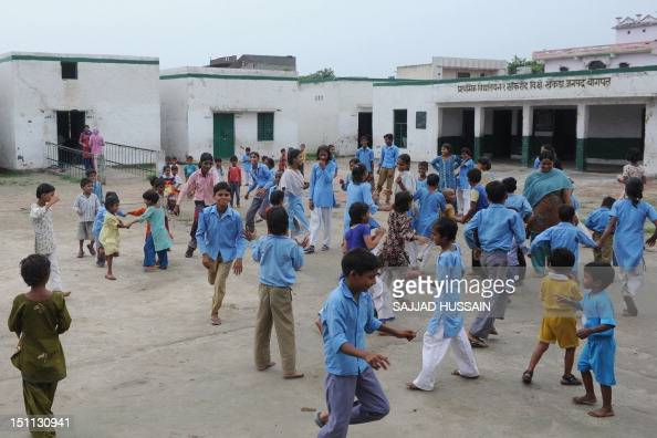LifestyleAsiaeducationIndiaFEATURE by Adam Plowright In a picture taken on August 30 Indian school children play during a break at a government...