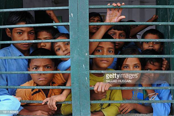 LifestyleAsiaeducationIndiaFEATURE by Adam Plowright In a picture taken on August 30 Indian school children look out from a classroom at a government...
