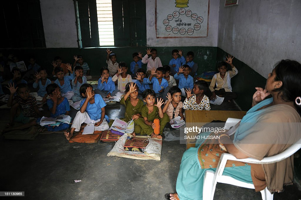 LifestyleAsiaeducationIndiaFEATURE by Adam Plowright In a picture taken on August 30 Indian school children read in a classroom at a government...