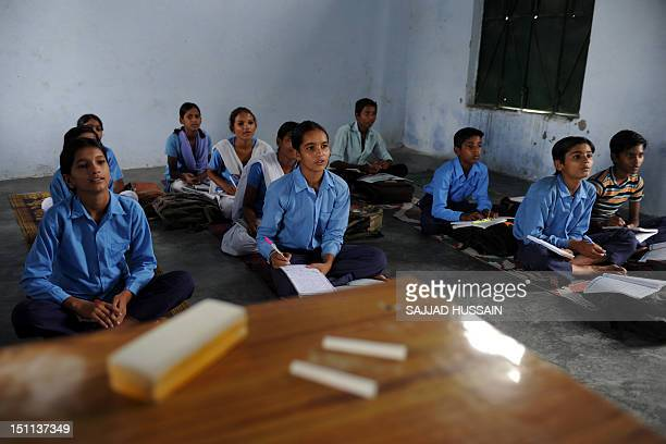 LifestyleAsiaeducationIndiaFEATURE by Adam Plowright Indian schoolchildren read in a classroom at a government school in Bagpath district in Uttar...