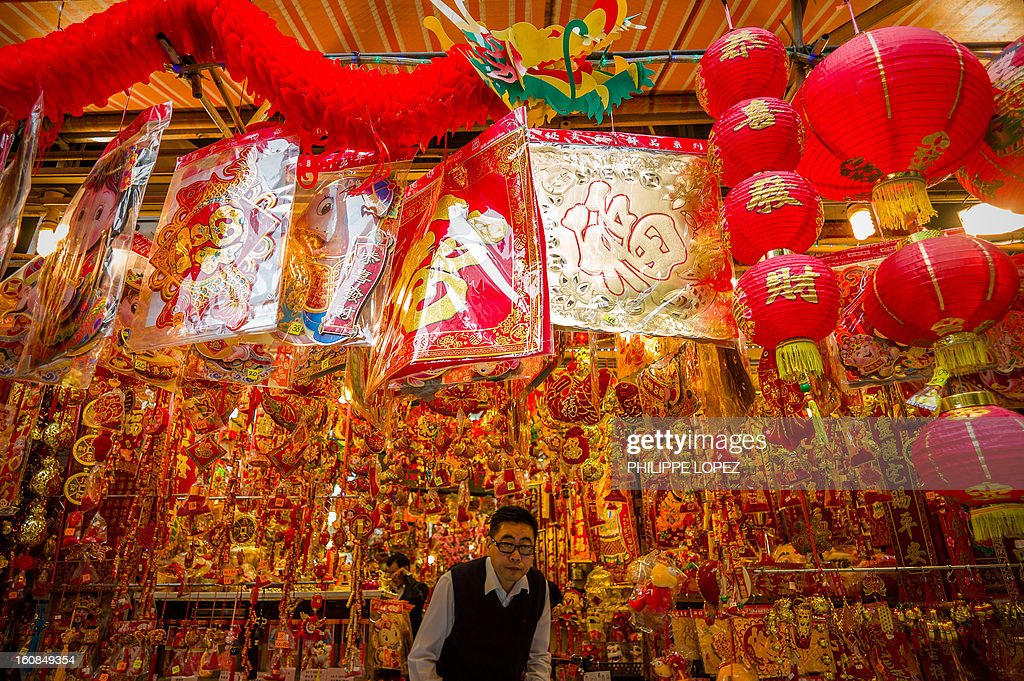 LifestyleAsiaoffbeatLunar FEATURE by Beh Lih Yi A man exits a shop selling Chinese New Year decorations in Hong Kong on February 5 2013 A stock...
