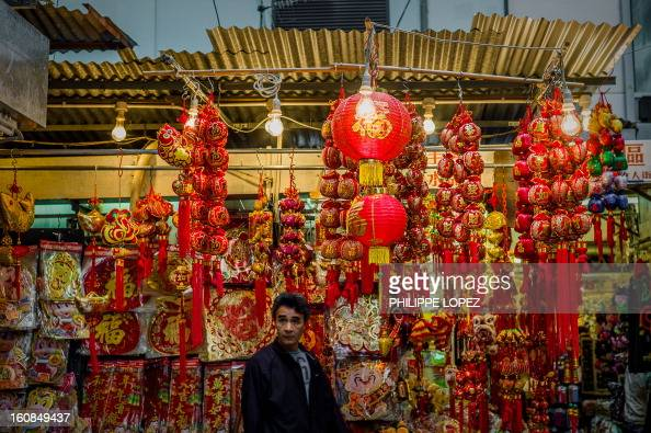 LifestyleAsiaoffbeatLunar FEATURE by Beh Lih Yi A man walks past a stall selling Chinese New Year decorations at a street market in Hong Kong on...