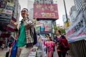 LifestyleAsiaoffbeatLunar FEATURE by Beh Lih Yi Pedestrians walk past a billboard set up for the Chinese New Year of the snake in Hong Kong on...