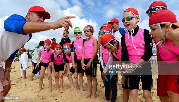LifestyleAustralialifesavingFEATURE by Madeleine Coorey Young children listen to instructions from a lifesaver as they participate in what is called...