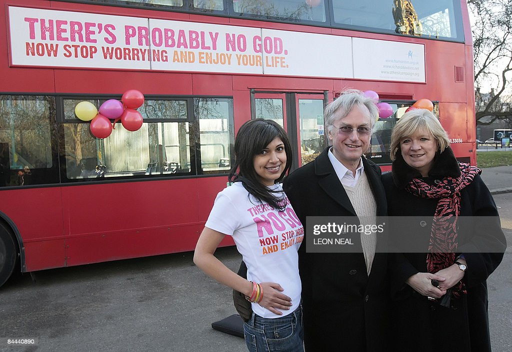 Lifestyle-Britain-religion-transport-atheism by Prashant Rao This phot taken on January 6, 2009 shows comedy writer Ariane Sherine, (L) professor Richard Dawkins (C) and Guardian writer Polly Toynbee (R) posing for pictures beside a London bus displaying an advertising campaign with the words 'There's probably no God. Now stop worrying and enjoy your life,' in London. Ariane Sherine objected to the Christian adverts on some London buses, which carried an Internet address warning that people who rejected God were condemned to spend eternity in 'torment in hell'. Eight hundred buses around Britain will carry the slogans as well as posters on the underground system in London. AFP PHOTO / Leon Neal