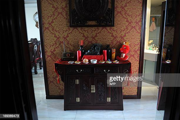 LifestyleChinadevelopmenteconomyFEATURE This picture taken on May 122013 shows an altar at Li Na's home in Beijing With two cars foreign holidays and...