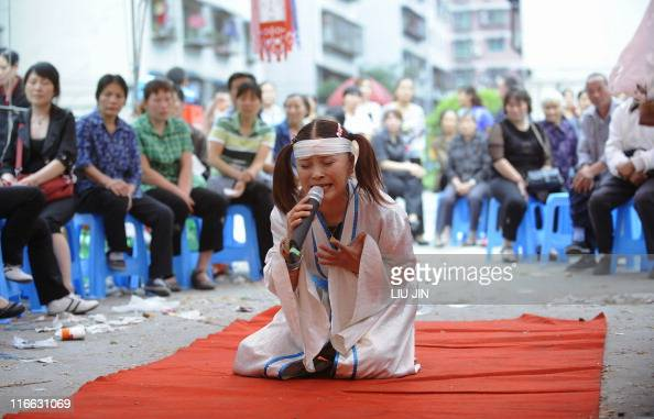 STORY 'LifestyleChinatraditiondeathFEATURE' by Sebastien Blanc This photo taken on June 1 2011 shows professional mourner Hu Xinglian at a funeral in...