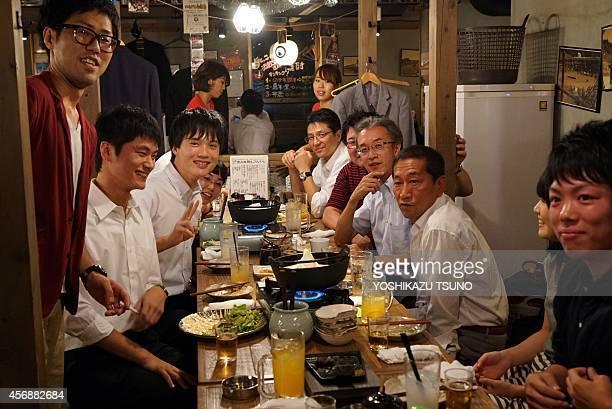 LifestylecommunitiestribesJapansalarymenemploymentFEATURE by Alastair Himmer This picture taken on October 3 2014 shows Japanese businessmen called...