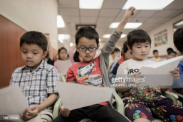 LifestyleeducationHongKonglanguageFEATURESPECIAL by Peter Hutchison This picture taken on September 29 2013 shows children attending a class to learn...
