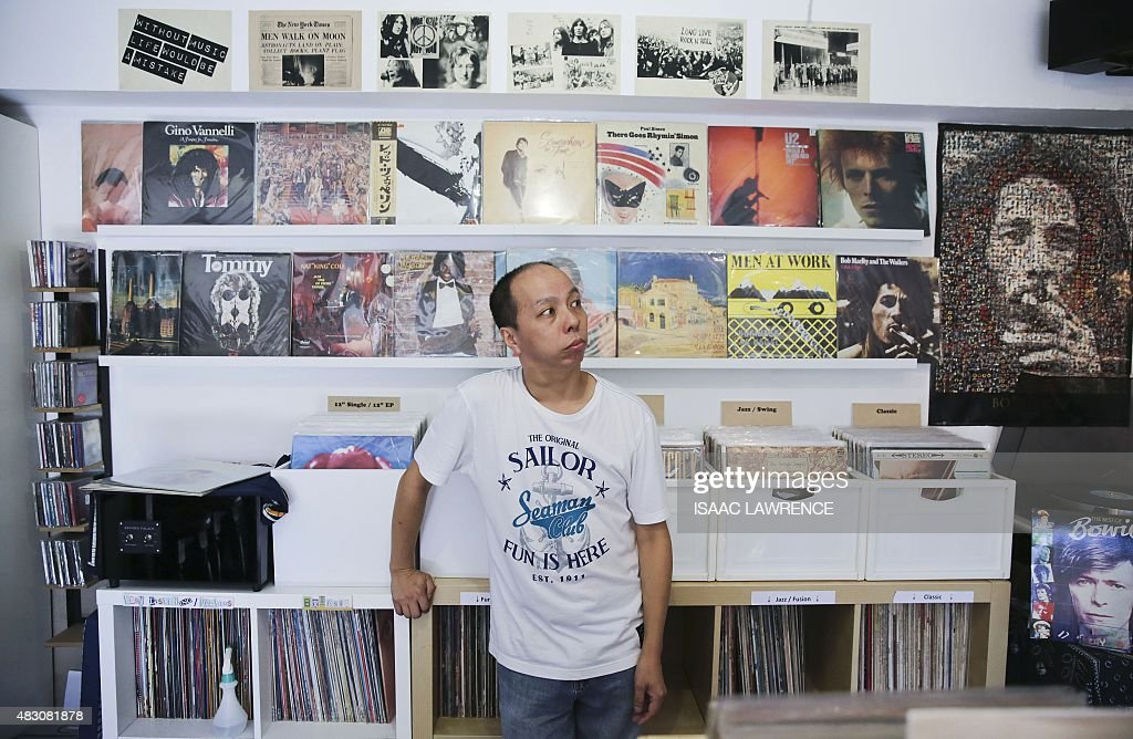 LifestyleHong Kongphotography FEATURE by Aaron Tam This picture taken on July 31 shows Ho Hing Ming posing for a photo in his record store on Lamma...