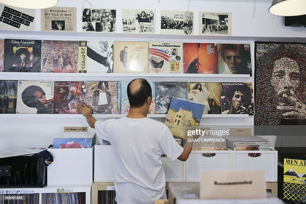 LifestyleHong Kongphotography FEATURE by Aaron Tam This picture taken on July 31 shows Ho Hing Ming sorting vinyl at his record store on Lamma Island...