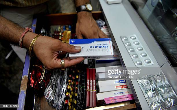 STORY 'LifestyleIndiahealthtourismFEATURE' by Phil Hazlewood In this photograph taken on October 20 2010 antibiotics are displayed at a chemist's...