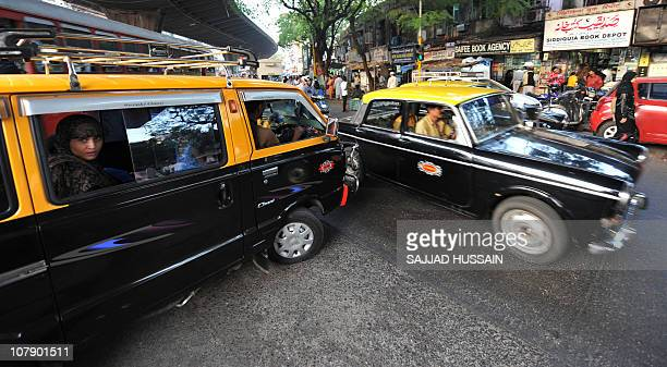 LifestyleIndiasocietyhealthangerFEATURE by Phil HazlewoodThis photo taken on December 23 2010 shows taxis during a traffic jam in Mumbai With its...