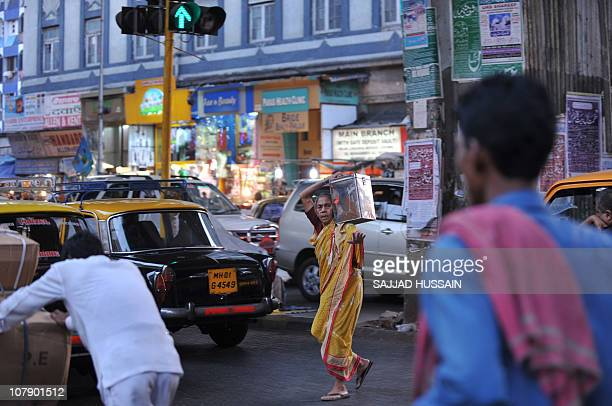 LifestyleIndiasocietyhealthangerFEATURE by Phil HazlewoodThis photo taken on December 23 2010 shows an Indian woman crossing a road in Mumbai With...
