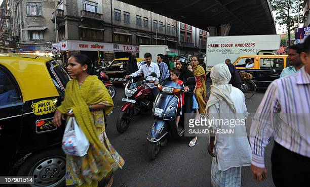 LifestyleIndiasocietyhealthangerFEATURE by Phil HazlewoodThis photo taken on December 23 2010 shows pedestrians and commuters during a traffic jam in...