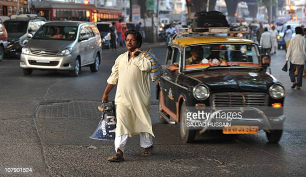 LifestyleIndiasocietyhealthangerFEATURE by Phil HazlewoodThis photo taken on December 23 2010 shows a pedestrian crossing a road amongst the traffic...