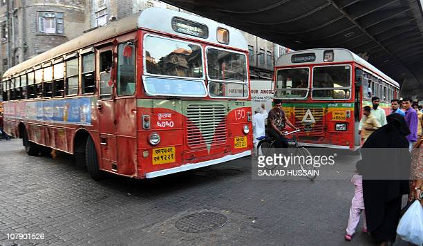 LifestyleIndiasocietyhealthangerFEATURE by Phil HazlewoodThis photo taken on December 23 2010 shows a cyclist riding his bicycle past buses during a...